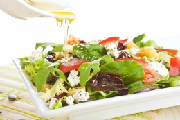 Fresh goat cheese salad with fresh vegetables and olive oil.
